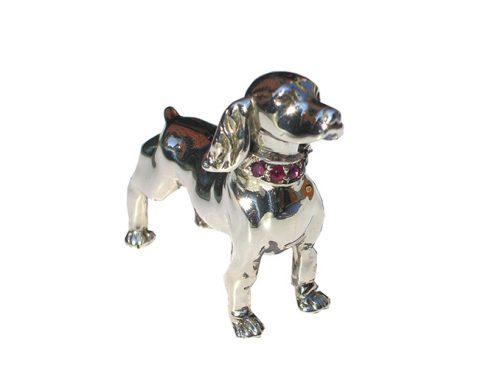 Lost wax carving of a dog cast in silver and set with ruby's-Daniel Gallie