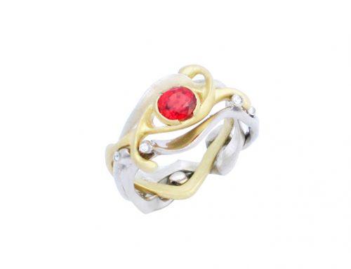 Interlocking eternity a combination of 3 different gold's set with a orange Sapphire and Diamonds RI-G027-Daniel Gallie