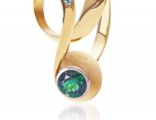 Infinity, flowing gold ring set with a vivid green tourmaline and pave diamonds RI-GD034-Daniel Gallie