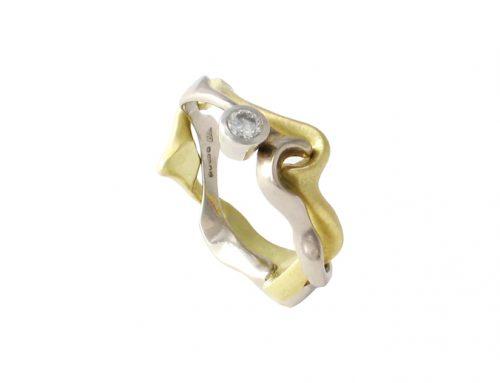18Ct white and yellow gold Interlocking engagement ring set with diamond-Daniel Gallie